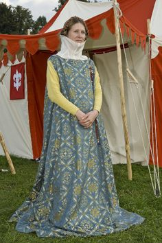 Woman's outfit      The outfit was made according to illuminations in Codex Balduini Trevirensis, 1320 – 1340, to be worn during the Tournament of Hradecký dvůr královny Elišky Rejčky. The outfit consists of the brocade sleeveless surcotte and the silk cotte, under which there are the shirt, drawers and stockings with garters tightened under knees. The surcotte and the cotte are made according to patterns of S. Thursfield (The medieval tailor's assistant), the pattern of the surcotte was…