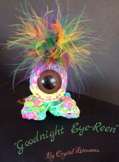 "Rainbow Loom EYE PEOPLE. Designed and loomed by Crystal Letourneau. ‎Rainbow Loom FB page 05/30/14. Crystal said: ""Going to be a series of the eye people."""