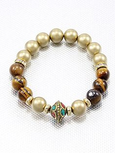 Brown and Gold, Fashion Indian Vintage Bracelet Bead Accent Stretch Style Materials Rhinestone Length 10 Inch Width 0.4 Inch Unknown http://www.amazon.com/dp/B00L1PGJOE/ref=cm_sw_r_pi_dp_3xMLvb09KNXQ8