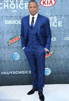 Dapper: The 46-year-old actor rocked a royal blue three-piece suit...