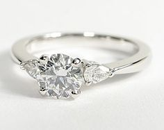 classic pear shaped diamond engagement ring in 14K white gold (1/4 ct. tw.) plus 1 ct center