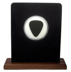 "Wood Display Stand For One (1) Guitar Pick (Black/White) 100% Made In USA! by Buffalo Music Store. $12.99. 100% MADE IN U.S.A. Display your special guitar pick in style! Contents: wood stand, velour display card, one acrylic pick case and foam guitar pick holder in a gift box (Guitar Pick Not Included). Velour Color: Black. Foam Guitar Pick Holder Color: White. Wood Stand: Maple wood with a cherry finish Dimensions of the display card: Approximately 3 1/2"" X 4 1/..."