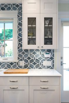 White and blue kitchen boasts white shaker cabinets painted Benjamin Moore White. White and blue kitchen boasts white shaker cabinets painted Benjamin Moore White… – Patterned Tile Backsplash, Kitchen Design Trends, Blue Kitchen Designs, Kitchen Remodel, Kitchen Countertops, Blue Kitchen Tiles, Blue Tile Backsplash Kitchen, White Shaker Cabinets, Kitchen Design
