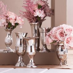 silver vases in different styles