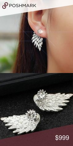 Coming Soon! Feather / Angel Wing Earrings Super cute and sexy stud post earrings. These are silver colored with a rhinestone. The metal is zinc alloy. These are so fun and flirty for a night out with the girls! Like to be notified of arrival. They will likely arrive today! Jewelry Earrings