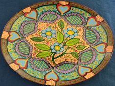 Here are some of the ceramic plates Luisa Cassella has painted. Acrylic paint, the plates are some new, some up-cycle.
