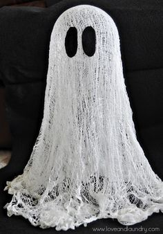 DIY Ghost using cheese cloth and cornstarch and water mix. Nice tutorial. I made these but I used Elmer's glue and water.
