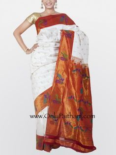 White #paithani saree rich tissue border with peacock and flower motifs all over.