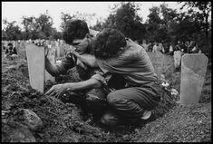 Bosnia, 1993 - Mourning a soldier killed by Serbs and buried in what was   once a football field.