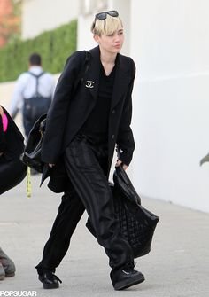 Miley also wore a Chanel brooch on her jacket.