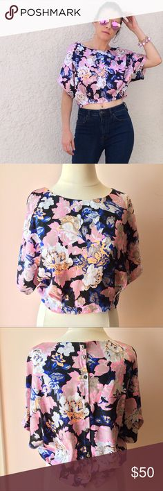 NWOT Floral Cropped Blouse NO TRADES. OFFERS WELCOME. PLEASE USE THE OFFER BUTTON. I DO NOT NEGOTIATE PRICE IN THE COMMENTS. Super pretty multi-colored floral blouse from ASTR brand sold at Nordstrom. Button up back. Blouson style. Cropped length. New without tags. Only worn for photoshoot. Model is size 2/4, size small. ASTR Tops Blouses