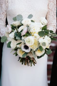 Ivory Bouquet with Eucalyptus   Photography: Green Vintage Photography Read More: http://www.insideweddings.com/weddings/modern-country-club-wedding-with-baseball-inspired-details/1043/