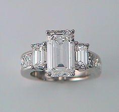 Brilliant White Emerald Cut Diamond Ring with Emerald Cut Side Stones and Radiant Band | K & W Jewelry - Kestenbaum & Weisner