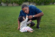 Or gives you a flower… | All The Times President Obama Lost His Chill Around Kids - BuzzFeed News