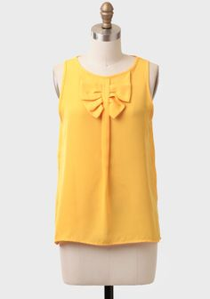 Capri Bow Detail Tank at #Ruche @Ruche [[My favorite yellow. With a high-waisted skirt... with jean carpi's... tucked under a blazer... The possibilities for this top are endless.]]
