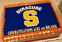 A double celebration for the Syracuse bound grads. The edible art is bordered with the orange buttercream that is the schools color.