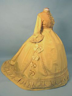 Paris yellow promenade gown c. 1868 I've always wondered how it would feel like to wear one of these...