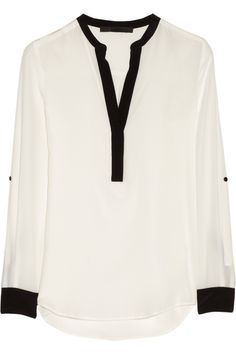 For a vintage look, a white contrast trim silk blouse is an effortless pick to complement high waisted flared hem pants; tuck it in slightly in the front to show off a high-waist silhouette.