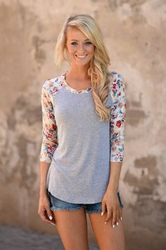 This adorable top is perfect to transition to fall.  True to size.  Model is 5'5'' wearing a small.  Material: 95% Rayon...