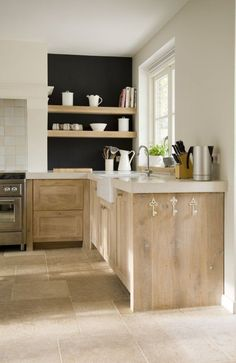 washed wood and white. love the black behind the shelves