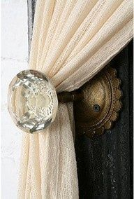 Doorknobs for curtain pulls.