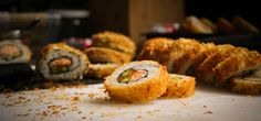 Making deep fried sushi at home is as easy as making other sushi varieties Learn to make a crisp and crunchy fried sushi dish by using a tempura batter Fried Sushi Roll Recipe, Deep Fried Sushi, Sushi Roll Recipes, Recipes Appetizers And Snacks, Las Vegas Sushi Roll Recipe, Tempura Sushi, Tempura Batter, Tempura Roll, Crispy Rolls