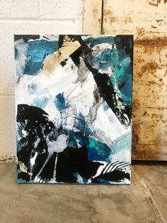 Heavily textured contemporary painting, abstract colors of black, white, teal and gold