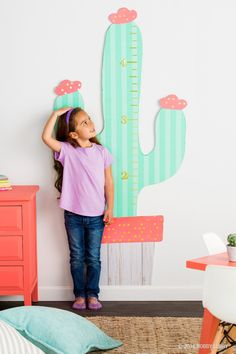 With poster board, custom growth charts are as limitless as she is!