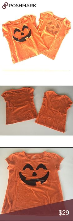 2 Cap Sleeve Halloween Shirts So cute for your little pumpkin! One has black glittery face. One has orange sequin face. Gently worn. Some mild signs of wear from normal use. Size Medium (7-8). Halloween Shirts & Tops Tees - Short Sleeve