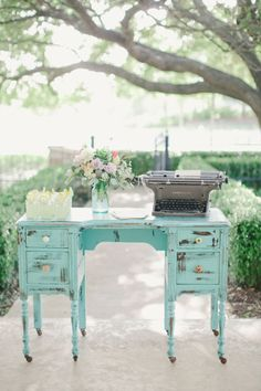 Vintage aqua blue vanity makes a perfect setting for your cake table. Add an antique typewriter, some lace, vases filled with flowers and you have a beautiful setting.