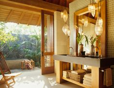 Asian inspired indoor/outdoor bathroom design with lantern pendant lights, and a stone bathtub outside. Indoor Outdoor Bathroom, Outdoor Tub, Outdoor Baths, Outdoor Stone, Outdoor Showers, Rustic Outdoor, Bad Inspiration, Bathroom Inspiration, Tropical Bathroom Decor