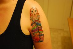 Owl with books tattoo...but I'd use a different owl
