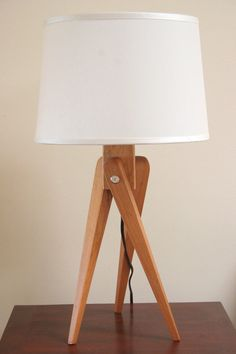 Handcrafted beauty: a tripod lamp fashion from American Black Cherry wood.