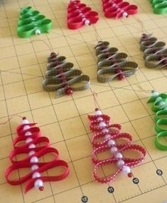 Ribbons and beads = christmas trees. Fun little ornaments. Craft to do with the kids by Debra Beach