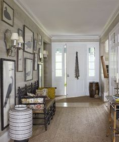 foyer w/ frames hung to the baseboard ...Tom Scheerer. MC- like this. a little weird, a little tailored/classic, a little global.