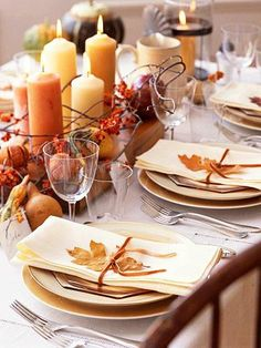 Autumn glow. To create a low centerpiece that encourages conversations even across the table, group fall-hue pillar candles of different heights on top of a wood cutting board. Finish the look with dried oranges, fall gourds and bittersweet. For coordinating place settings, top each napkin with a single fall leaf, and tie a velvety ribbon around the middle.