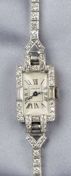 Art Deco Platinum and Diamond Wristwatch, Cartier, the white metal dial with Roman numeral indicators, enclosing manual-wind European Watch  Clock Company Inc. 17-jewel movement, case set with single-, rose-, and baguette-cut diamonds, completed by an associated platinum bracelet, with transitional-cut diamond melee, approx. total wt. 2.05 cts., lg. 6 1/2 in., case no. 24200 with guarantee stamp, dial signed.