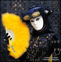 Photograph of Fancy mask with fan during Venice carnival, Italy photo