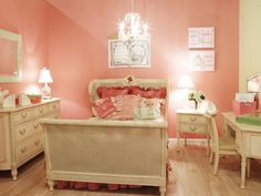 The custom bedding and wall art are color coordinated and complement the sweet, girly coral-colored walls.Discover more kids room decorating and organizing tips and ideas @ http://kidsroomdecorating.net