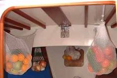 Net hammocks for storing fruit and vegetables on a long offshore passage in a sailboat