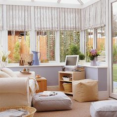 Cool conservatory The walls if this conservatory have been kept light and bright  with an ivory shade to maximise daylight. The colourful bl...