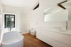 Modern loft bathroom with bathtub and stunning timber floor