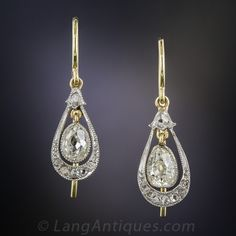 Antique Pear Shape Diamond Drop Earrings. Simply delightful and eminently wearable, diamond ear drops dating from the first decade of twentieth century. A matched pair of old mine-cut pear shape diamonds, together weighing just under one carat, sparkle from within finely milgrained platinum bezel settings and swing back & forth inside delicate frames glittering with tiny rose-cut diamonds. Lightly and lovingly hand fabricated in platinum over 18K yellow gold, they measure 1 inch long