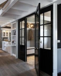 Black interior doors - entrance from foyer or mudroom area.  This house has amazing millwork.