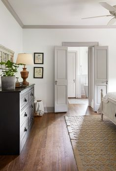 White walls with warm light gray trim. The Scrivano House from Fixer Upper Bedroom decor Bedroom Doors, Home Decor Bedroom, Bedroom Furniture, Modern Bedroom, Diy Bedroom, Light Gray Bedroom, Taupe Bedroom, Farm Bedroom, French Doors Bedroom