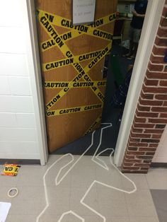 Dorm door halloween decorations! Caution tape and murder body tape line.