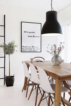 Thanks to a black-and-white color palette—the hallmark of Scandinavian interior design—one IKEA piece blends in seamlessly with this modern living room. Can you find it? It's the...