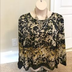 Vince Camuto plus size Silk Blouse Stunning silk high-low Vince Camuto top. Long sleeves, button detail at neck and split tail. So gorgeous! Barely worn. Like new. Vince Camuto Tops Blouses