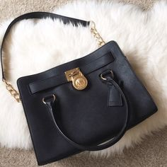 Small Black Michael Kors Hamilton Satchel Black Hamilton bag, can be worn on the shoulder or arm. Still in great condition, the straps may be a bit tarnished and the inside is a little dirty, but nothing major. There is also some wear near the lock. 100% authentic. NO TRADES OR PAYPAL. MICHAEL Michael Kors Bags Satchels