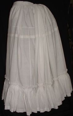 C.1885. A beautiful and rarely found full petticoat to go over a large bustle. These petticoats added extra fullness to the skirt, and softened the lines caused but the metal ribs of the bustle. Bustle petticoats are very hard to find, as later on when skirts grew slimmer, they were often cut down into A line petticoats during the 1890's and Edwardian era.